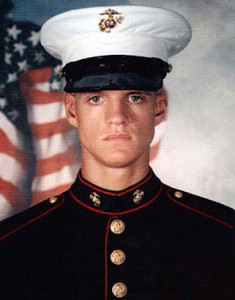 U.S. Marine Cpl. Jason Dunham, shown in this undated family photo, was buried, Saturday, May 1, 2004, in Scio, N.Y. Dunham died April 22, at Bethesda Naval Hospital in Bethesda, Md. Relatives say Jason never regained consciousness after sustaining a head injury from a shrapnel wound, April 14, in the Iraqi city of Karbala.  The oldest of four children, Dunham enlisted in the Marine Corps in 2000 after graduating from Scio Central School near Buffalo. His father, Daniel Dunham, said Jason was scheduled to be out of the service in July. (AP Photo/The Wellsville Daily Reporter, courtesy Dunham family)